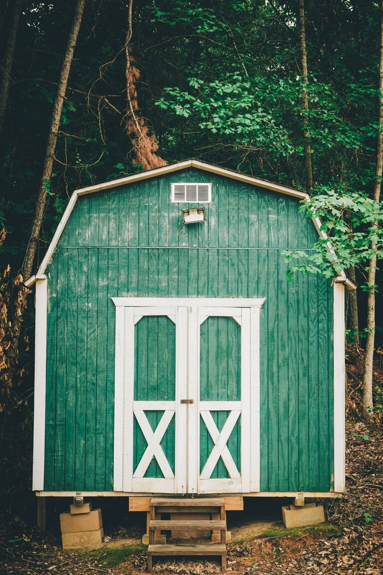 Green shed in the backyard